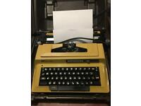 Vintage 2 X Smith and Corona portable electric typewriters in cases
