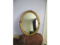 gold mirror, very decorative gold coloured mirror,
