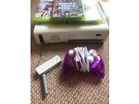 Xbox 360 with controller, 3 games, wireless adapter and all wires.