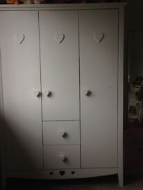 White triple wardrobe with heart shaped patterning