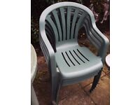 Green heavy duty plastic patio table and four (4) chairs.