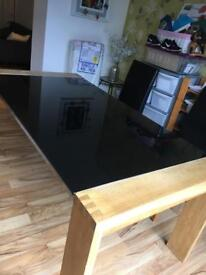 Large wooden black glass topped dining table