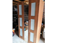 Wardrobe with pullout mirror and shoe rack
