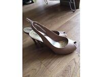 High heeled nude shoes - size 7