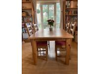 Solid wooden table and four chairs £150