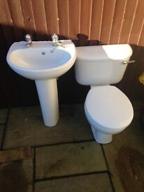 White toilet pan and sink with pedestal
