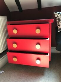 Chest of red Drawers