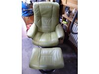 2 apple green leather stressless chairs with footstools for sale.