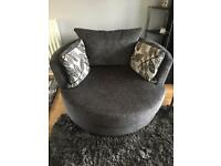 Grey 2 seater sofa and swivel chair with all cushions.