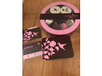 Cake tin, cup cake cases and recipe tin from Hummingbird bakery range