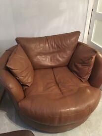 Tan leather round snuggler sofa