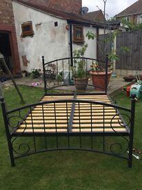 Black powder coated metal frame with wooden slats