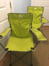 Two lime green camping chairs with carry bags - new