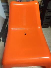 Orange plastic funky chair