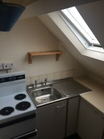 BEDSIT WITH KITCHEN & SHARED BATHROOM CLOSE TO TOWN CENTRE.