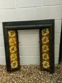 Cast iron tiled fireplace surround