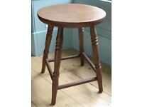 A USEFUL WOODEN STOOL