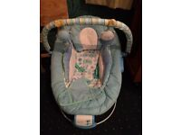 Baby bouncy chair musical/vibrates