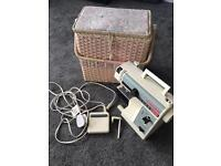 Singer Compact 324 free arm sewing machine and carry basket