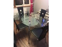 Oval table and four chairs £50