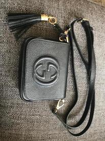 Gucci clutch bag.