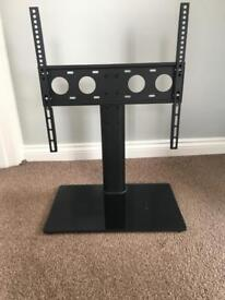 Universal tv stand with glass base