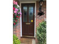 Glazed mahogany brown front door with Yale Lock, frame and step