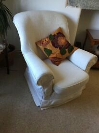 Free. One arm chair with off white loose covers.