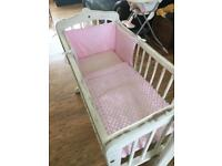 Swinging Crib and bedding