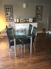 Contemporary glass extendable dining chair with 6 faux leather, high back, dining chairs.
