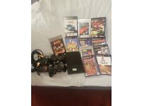 Black Playstation 2 Slimline with 2 Controllers and 11 games a