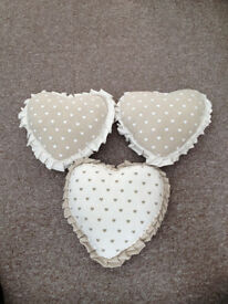 3 small heart shaped cushions