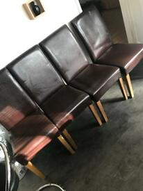 4 leather type brown dining chairs