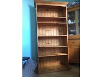 Tall wooden shelf in good condition