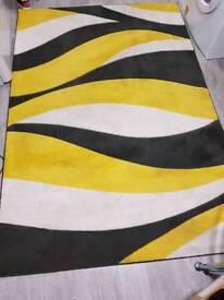 Large yellow & grey rug.