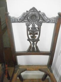 Two beautiful antique carved chairs.