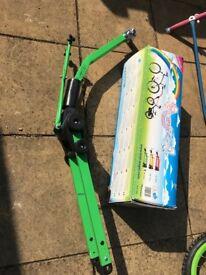 Trail angle towing bar for kids bike