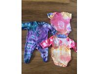 Tiny baby vests and babygrow
