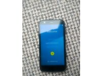 Motorola Moto G with original box, phone case and charger
