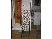 tall cast iron wine rack