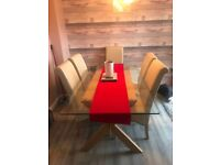 Glass and wood dining table with 6 cream leather chairs modern and contemporary