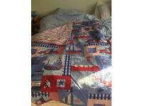 Boys bed-cover. Dual-sided transport-themed and striped.