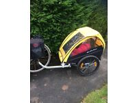 Burley Bee trailer. Used but In good condition. Takes two children, easy to attach, really good!