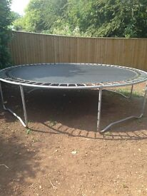 A 12 ft trampoline, no safety net, but easy to set up and in good condition