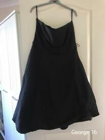 Black strapless dress with flare out skirt