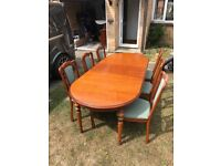 J.E coyle table and chairs