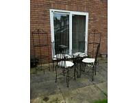 Cast iron table and 4 chairs with 2 matching shelves