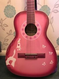 Stagg guitar and case in pink and purple.