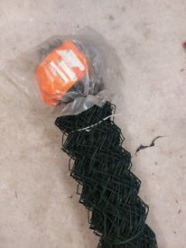 Chain linked plastic coated fence wire