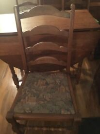 Drop leaf solid English Oak dining table with 4 tapestry cushioned chairs. Good condition £120 ono